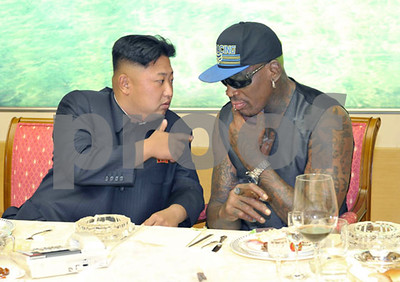 dennis-rodman-trying-to-open-a-door-in-north-korea