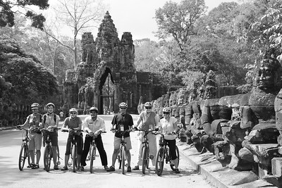 A group heading into Angkor Thom by bike