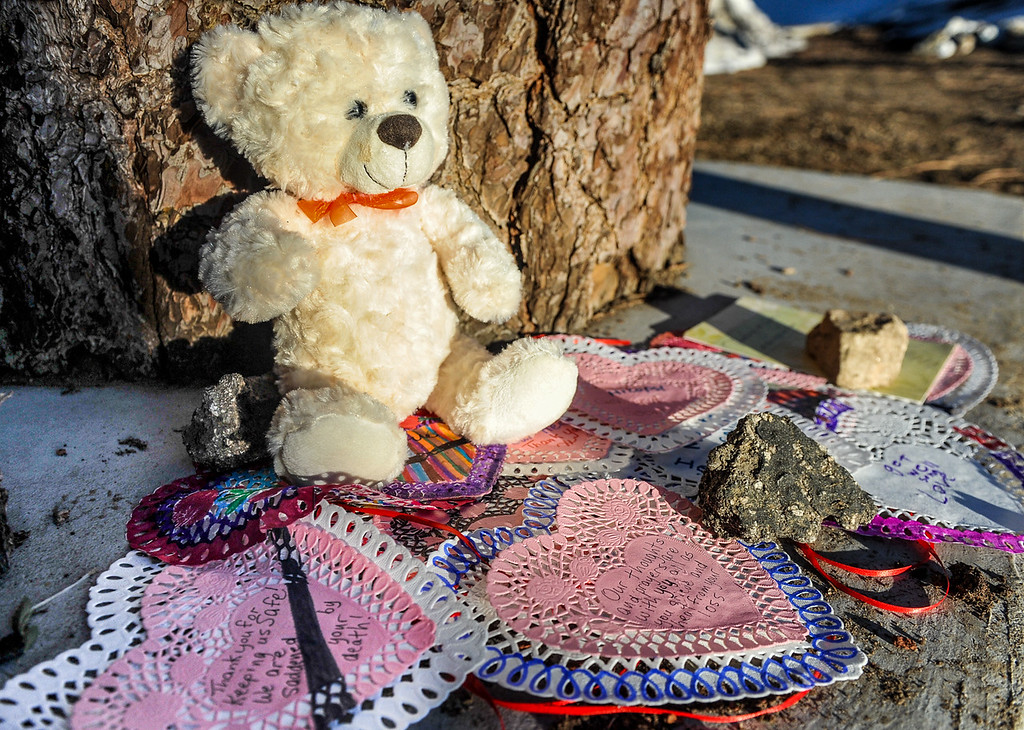 . A makeshift memorial has grown near a wood-carved bear at the Sheriff\'s Station in Big Bear on Thursday, Feb. 14, 2013. Valentine\'s Day cards, sympathy cards, balloons and flowers paid tribute to the law enforcement personnel who were involved and lost in the Christopher Dorner manhunt. (Rachel Luna / Staff Photographer)
