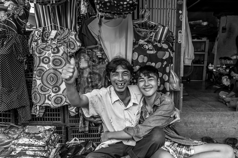 Happy man and son , garment retail shop .