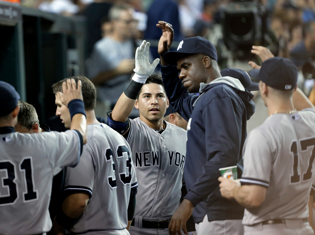 . New York Yankees\' Jacoby Ellsbury celebrates his solo home run against the Detroit Tigers in the fifth inning of a baseball game in Detroit Tuesday, Aug. 26, 2014. (AP Photo/Paul Sancya)