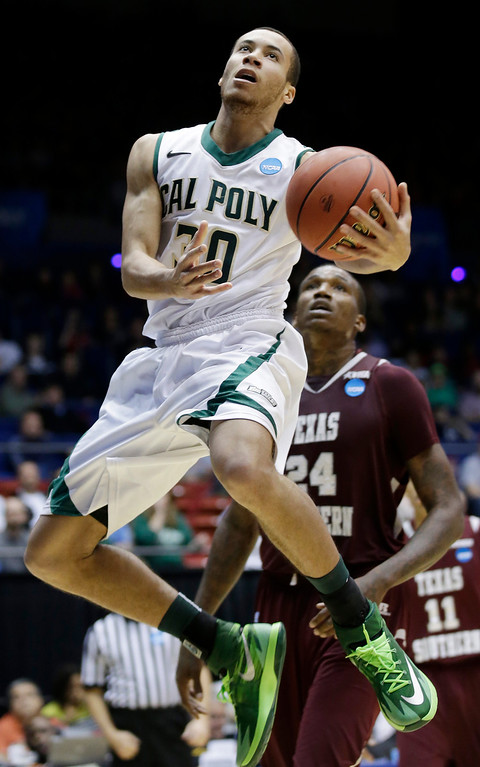 . Cal Poly guard Michael Bolden drives past Texas Southern center Aaric Murray (24) in the first half of a first-round game of the NCAA college basketball tournament on Wednesday, March 19, 2014, in Dayton, Ohio. (AP Photo/Al Behrman)
