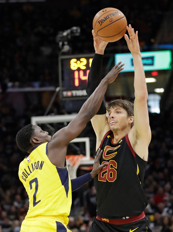 . Cleveland Cavaliers\' Kyle Korver (26) passes over Indiana Pacers\' Darren Collison (2) in the first half of Game 7 of an NBA basketball first-round playoff series, Sunday, April 29, 2018, in Cleveland. (AP Photo/Tony Dejak)