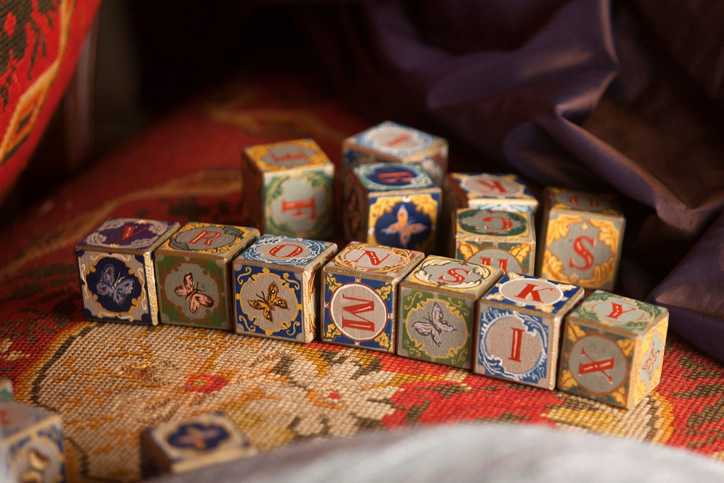 """. Beautiful painted blocks allow the shy suitor Levin and his intended Kitty to declare their love in \""""Anna Karenina.\"""" (Laurie Sparham/Focus Features)"""