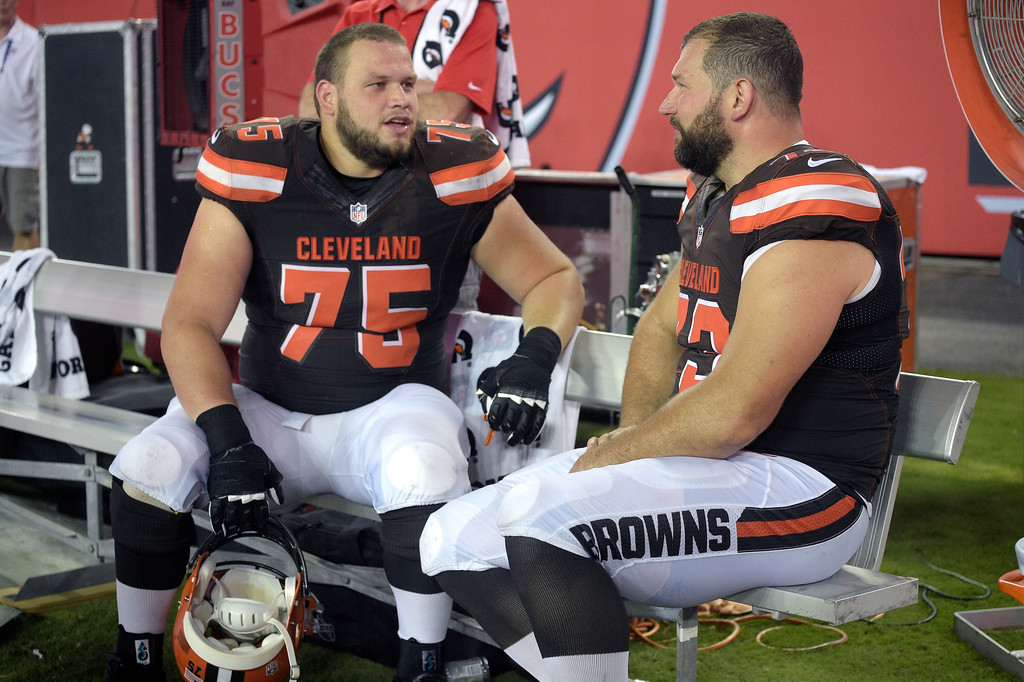 . Cleveland Browns guard Joel Bitonio (75) and tackle Joe Thomas (73) talk on the bench during the second half of an NFL preseason football game against the Tampa Bay Buccaneers in Tampa, Fla., Friday, Aug. 26, 2016. The Buccaneers won 30-13. (AP Photo/Phelan M. Ebenhack)