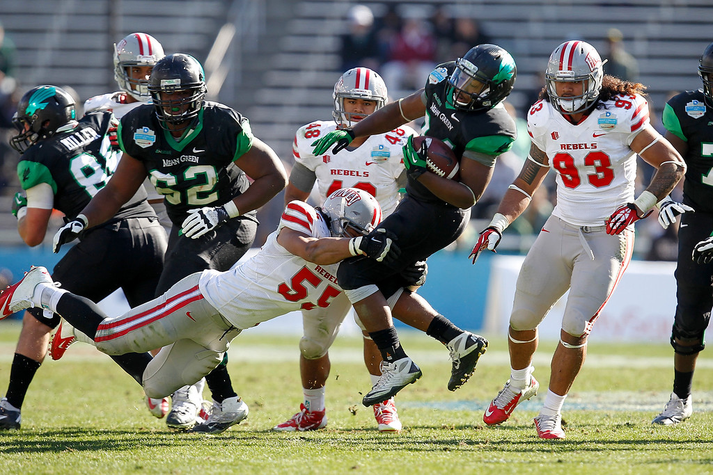 . DALLAS, TX - JANUARY 01: Brandin Byrd #24 of the North Texas Mean Green runs against the UNLV Rebels during the Heart of Dallas Bowl at Cotton Bowl Stadium on January 1, 2014 in Dallas, Texas.  (Photo by Sarah Glenn/Getty Images)