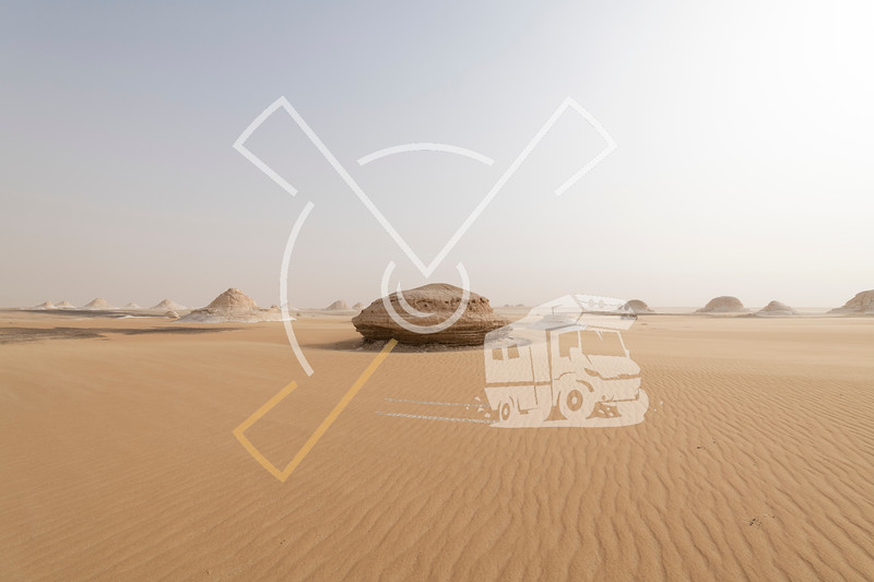 A sandstorm giving a mysterious atmosphere to the already bizarre landscapes of the White Desert National Park in Egypt