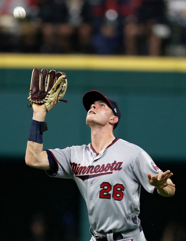 . Minnesota Twins\' Max Kepler catches a ball hit by Cleveland Indians\' Edwin Encarnacion during the first inning of a baseball game Tuesday, Aug. 7, 2018, in Cleveland. (AP Photo/Tony Dejak)