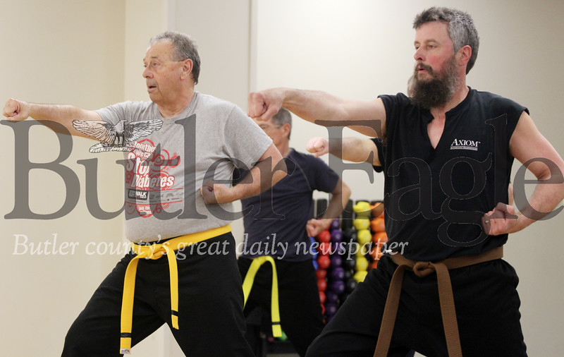 Harold Aughton/Butler Eagle: Army veterans Brad Edwards of Oakland Twp. (left) and Tom Genaway of Prospect participate at a recent martial arts class at the Butler Veterans Administration Health Care Center.