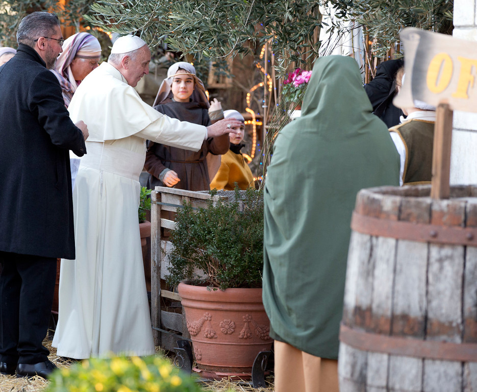 . Pope Francis visits a living nativity scene staged at the St. Alfonso Maria de\' Liguori parish church, in the outskirts of Rome, Monday, Jan. 6, 2014. The Epiphany day, is a joyous day for Catholics in which they recall the journey of the Three Kings, or Magi, to pay homage to Baby Jesus. (AP Photo/Andrew Medichini)
