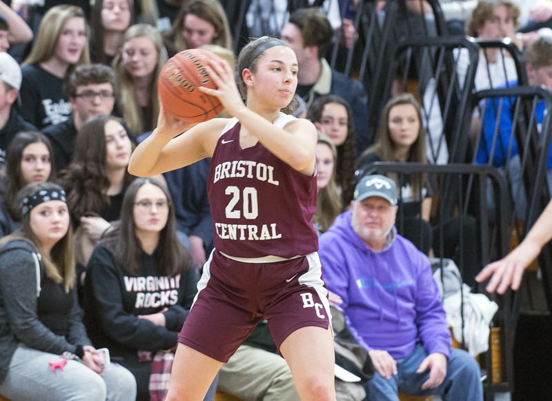 01/27/20   Wesley Bunnell | Staff  Bristol Central girls basketball was defeated in an away game at Lewis Mills on Monday night. Gwenyth Torreso (20) looks to pass.