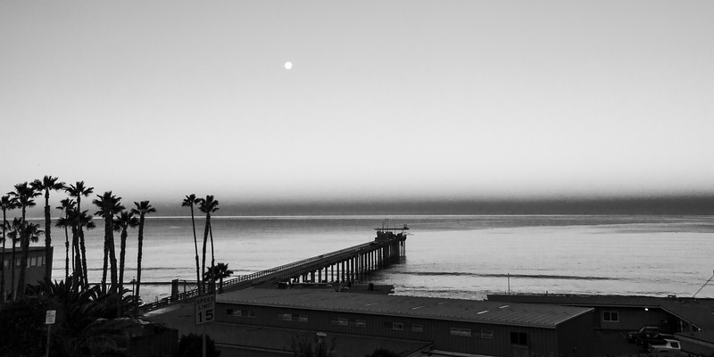 Sunrise, with  the full moon over Scripps Institute.