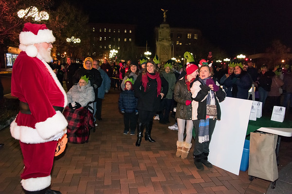 11/29/18 Wesley Bunnell | Staff New Britain held their tree lighting ceremony with a visit from Santa on Thursday evening at Central Park. Santa pauses for a moment to look over the crowd and say hello.