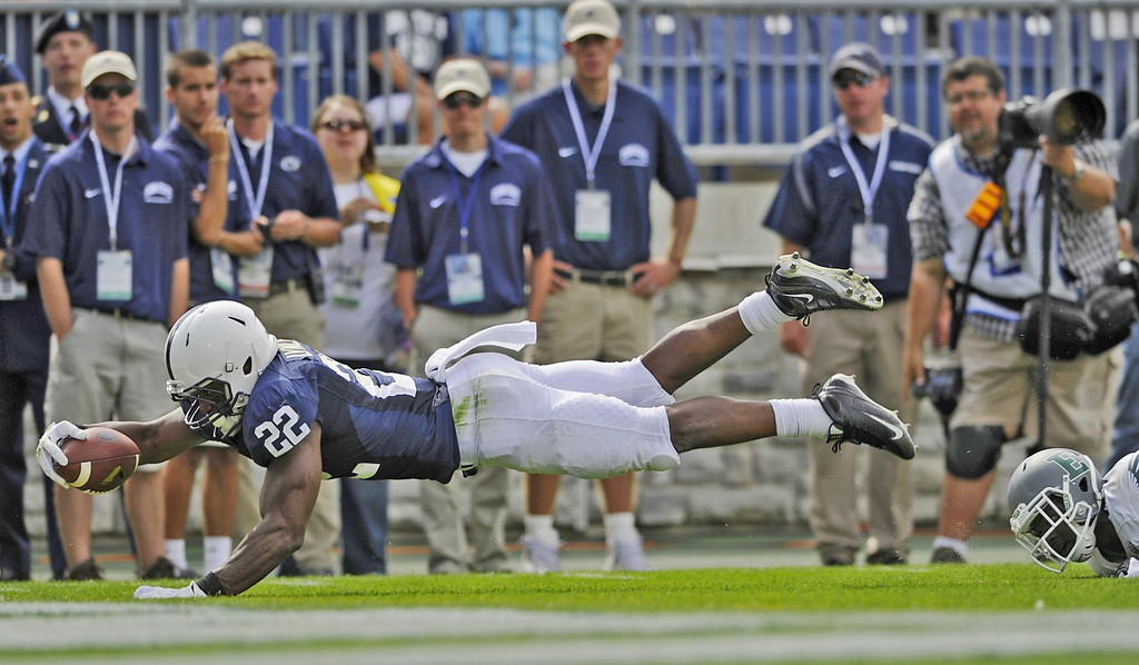 . Penn State\'s Akeel Lynch dives into the end zone after catching a pass from quarterback Tyler Ferguson in the fourth quarter of an NCAA college football game against Eastern Michigan,  Saturday, Sept. 7, 2013 in State College, Pa. . Penn State defeated Eastern Michigan  45-7. (AP Photo/York Daily Record, Chris Dunn)