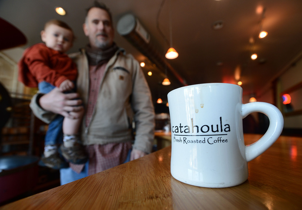 . Catahoula Coffee Company owner Tim Manhart holds 14-month-old son Nicholas at the coffee shop in Richmond, Calif. on Thursday, Jan. 17, 2013. In addition to the coffee shop on San Pablo Ave., Catahoula coffee is available at select local retailers like Berkeley Bowl and Monterey Market. (Kristopher Skinner/Staff)