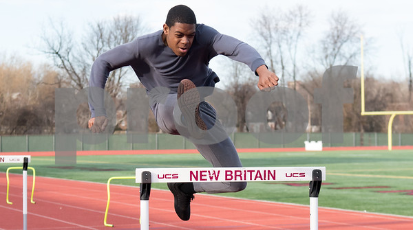 02/26/18 Wesley Bunnell | Staff NBHS Junior Jonathan Lindsay runs the hurdles as the rest of his indoor track team spent Monday afternoon holding outdoor practice at Veterans' Stadium taking advantage of the mild weather.