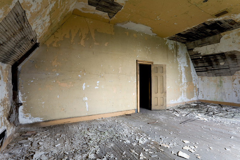 Workers' break room in attic of brick wards, Buffalo State Hospital.  During the height of overcrowding, this would have been turned into a dormitory.