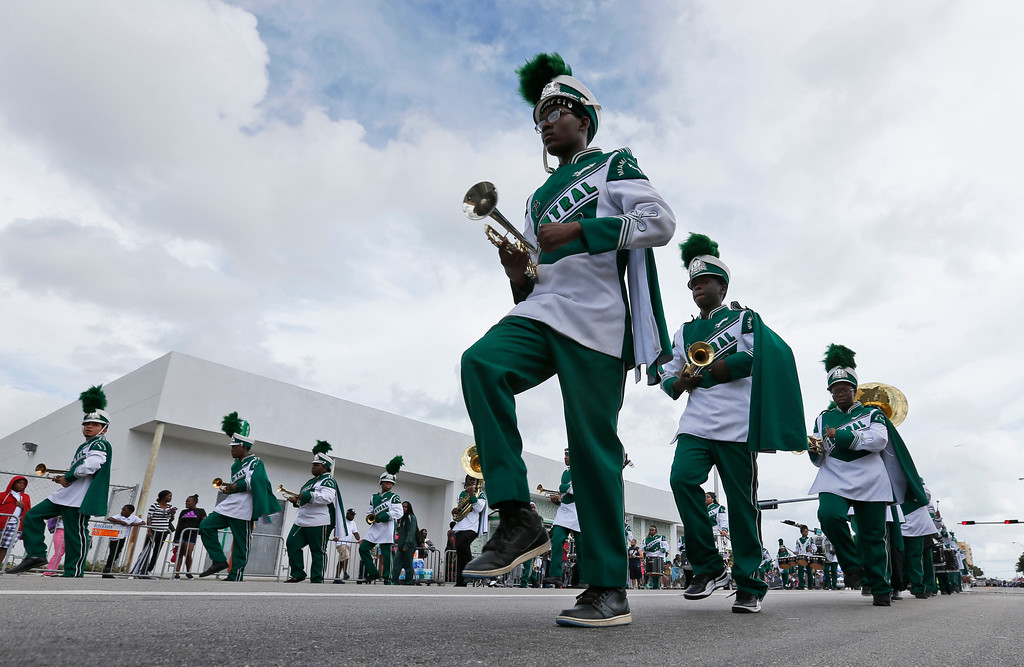 . Members of the Miami Central High School marching band perform during a parade honoring Martin Luther King Jr., Monday, Jan. 16, 2017, in the Liberty City neighborhood of Miami. (AP Photo/Wilfredo Lee)