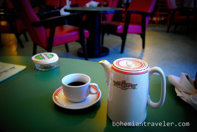 pot of coffee at the Coliseum Cafe in Kuala Lumpur.jpg