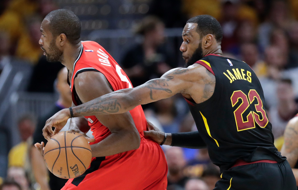 . Cleveland Cavaliers\' LeBron James (23) strips the ball from Toronto Raptors\' Serge Ibaka in the first half of Game 4 of an NBA basketball second-round playoff series, Monday, May 7, 2018, in Cleveland. (AP Photo/Tony Dejak)