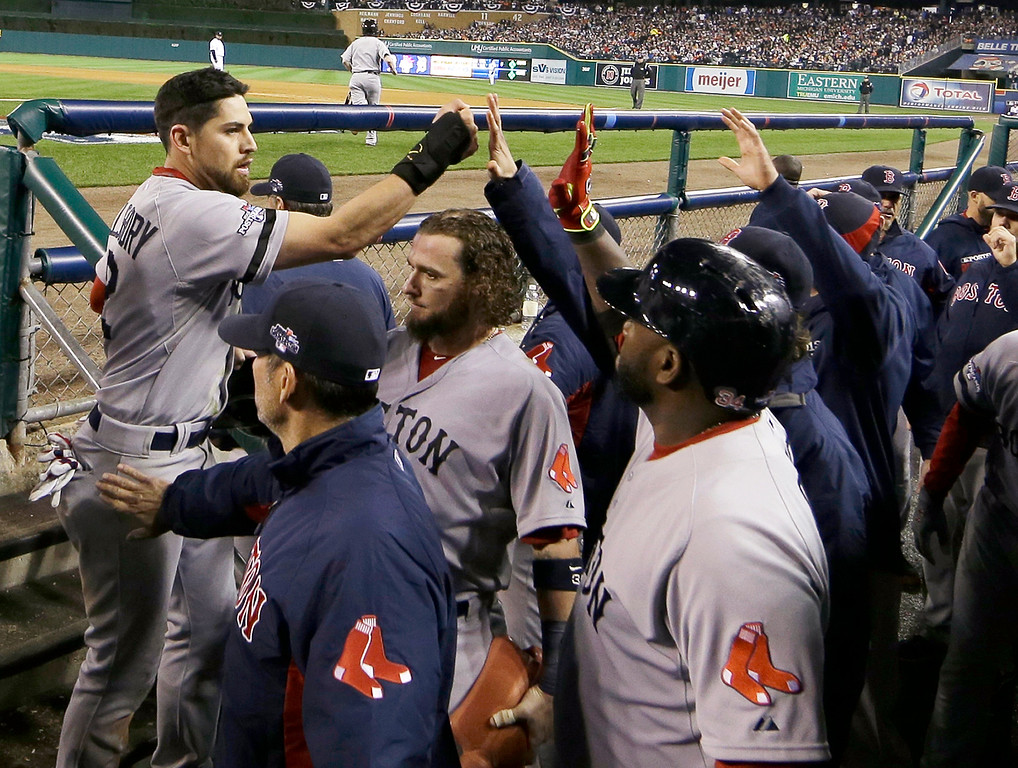 . Boston Red Sox\'s Jacoby Ellsbury is greeted after scoring in the seventh inning during Game 4 of the American League baseball championship series against the Detroit Tigers, Wednesday, Oct. 16, 2013, in Detroit. (AP Photo/Matt Slocum)