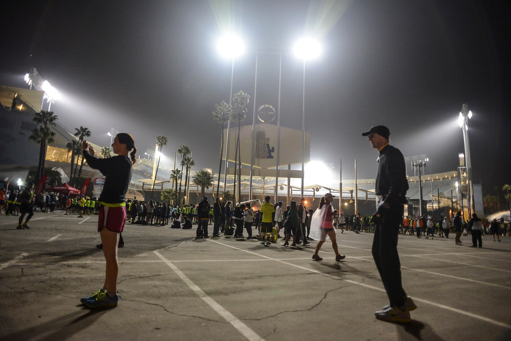 . Runners move into their start positions before the start of the LA Marathon Sunday at Dodger Stadium. Photo by David Crane/Staff Photographer