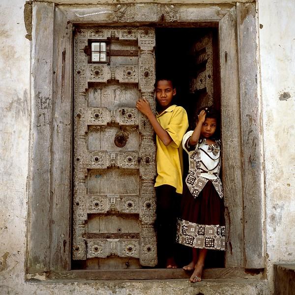 TZ Children in Traditional Doorway Stone Town Zanzibar May 03 H-86.jpg