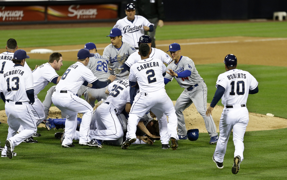 . San Diego Padres\' Carlos Quentin and teammates battle the Los Angeles Dodgers after Quentin was hit by a pitch thrown by Dodgers pitcher Zack Greinke in the sixth inning of baseball game in San Diego, Thursday, April 11, 2013. (AP Photo/Lenny Ignelzi)