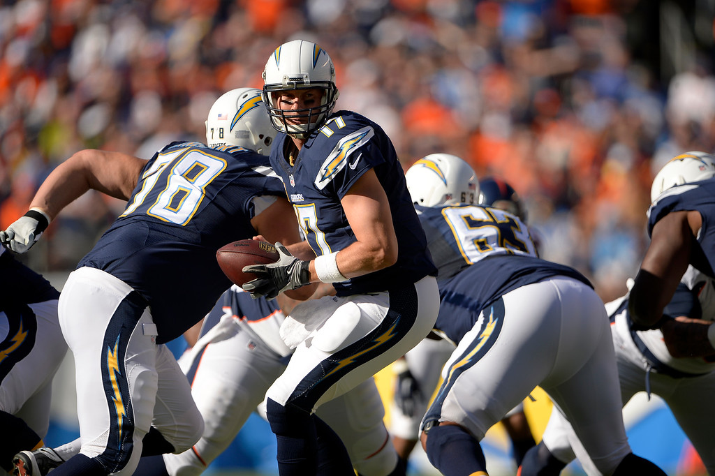. SAN DIEGO, CA. December 14, - quarterback Philip Rivers #17 of the San Diego Chargers in the first half  at Qualcomm Stadium December 14, 2014 San Diego, CA (Photo By Joe Amon/The Denver Post)