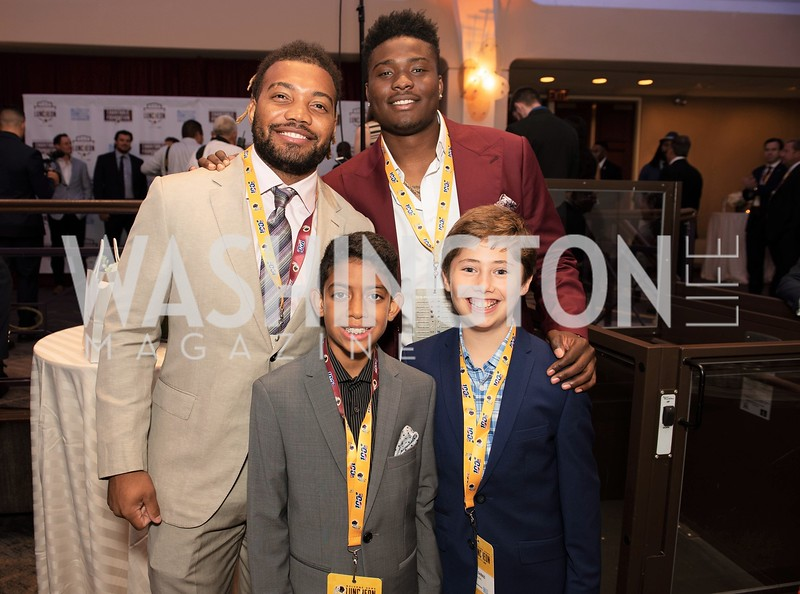 Derrius Guice, Dwayne Haskins and young fans. Photo by Yasmin Holman. Washington Redskins Lunch 2019. Washington Hilton. 08.28.19