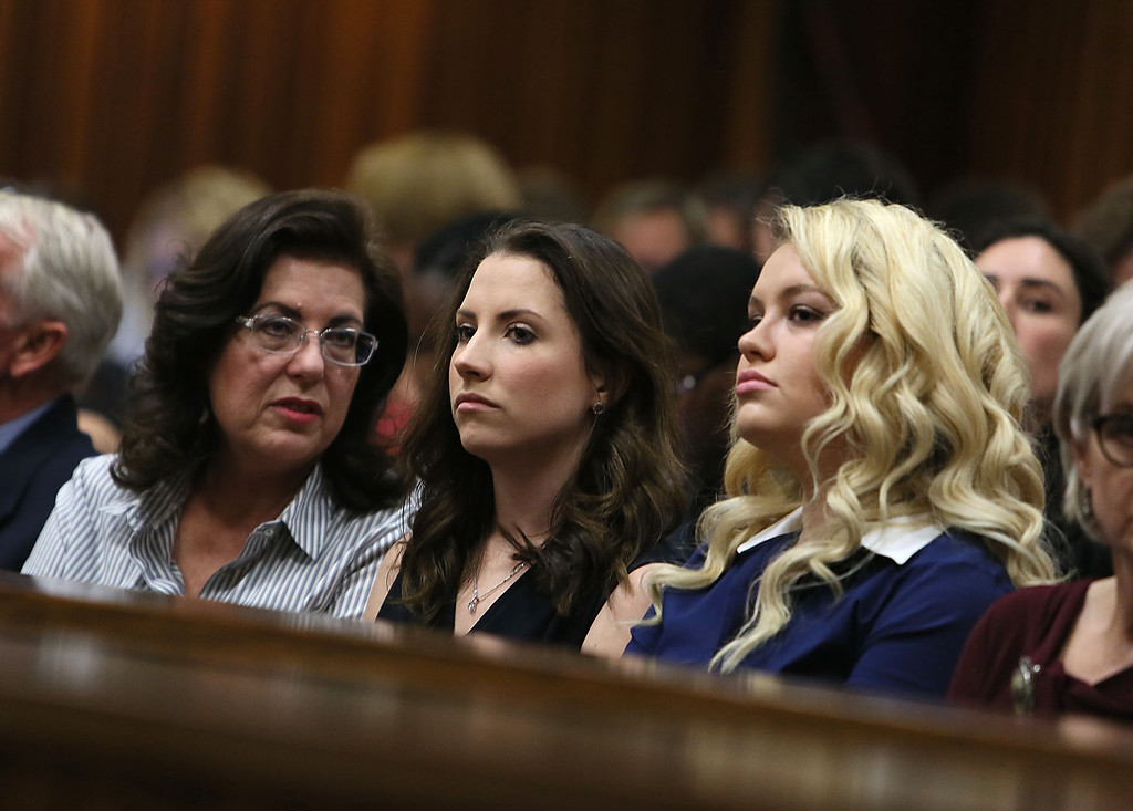 . Sister of Oscar Pistorius, Aimee Pistorius, center, listens to judgement in court  in Pretoria, South Africa, Friday, Sept. 12, 2014.  Judge Thokozile Masipa found Oscar Pistorius guilty of culpable homicide and an arms related charge. (AP Photo/Alon Skuy, Pool)