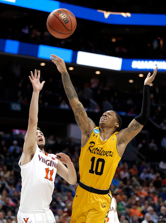 . Virginia\'s Ty Jerome (11) shoots over UMBC\'s Jairus Lyles (10) during the first half of a first-round game in the NCAA men\'s college basketball tournament in Charlotte, N.C., Friday, March 16, 2018. (AP Photo/Bob Leverone)