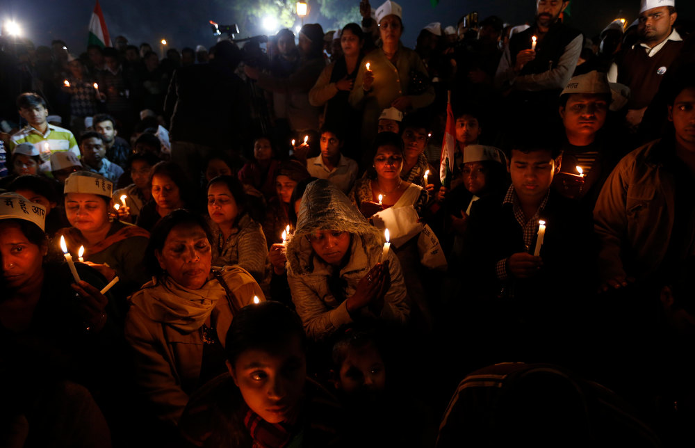 . Indians stage a candlelight vigil for the fast recovery of a young woman as she fights for her life at a hospital after being brutally raped and tortured, in New Delhi, India, Friday, Dec. 21, 2012. Indian officials announced Friday a broad campaign to protect women in New Delhi following the recent gang rape and brutal beating of a 23-year-old student on a moving bus in the capital. (AP Photo/ Saurabh Das)