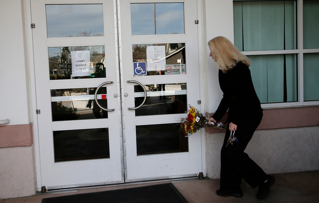""". A woman who did not want to be identified places flowers for slain Santa Cruz police officers, <a href=\""""http://www.santacruzsentinel.com/localnews/ci_22676928/loran-butch-baker-28-year-veteran-leaves-legacy\"""">Sgt. Loran \""""Butch\"""" Baker</a> and detective <a href=\""""http://www.santacruzsentinel.com/localnews/ci_22676931/santa-cruz-police-detective-elizabeth-butler-policing-was\"""">Elizabeth Butler</a> in front of the police department in Santa Cruz, Calif. on Wednesday, Feb. 27, 2013. The pair were <a href=\""""http://www.santacruzsentinel.com/localnews/ci_22674808/breaking-2-officers-1-suspect-shot-santa-cruz\"""">gunned down yesterday</a while investigating a possible domestic violence or sexual assault when a suspect fired at them. The gunman, Jeremy Peter Goulet, was later gunned down when he exchanged gunfire with police during a manhunt. (Gary Reyes/ Staff)"""
