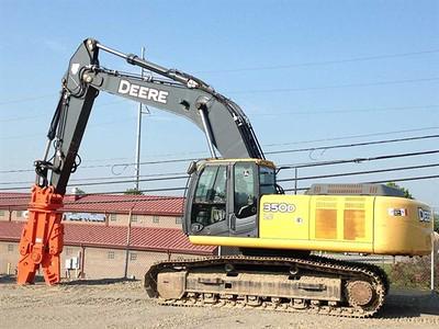 NPK M38G concrete pulverizer on Deere excavator.jpg