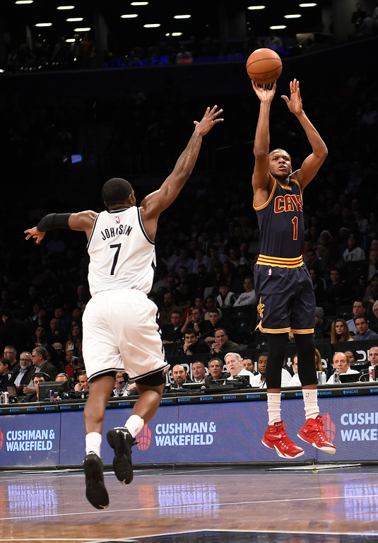 . Cleveland Cavaliers forward James Jones (1) takes aim for the basket over Brooklyn Nets forward Joe Johnson (7) in the first half of an NBA basketball game on Friday, March 27, 2015, in New York. (AP Photo/Kathy Kmonicek)