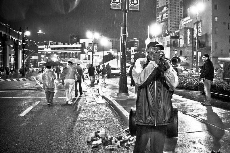 Trumpet Player In the Rain Detroit (1 of 1).jpg