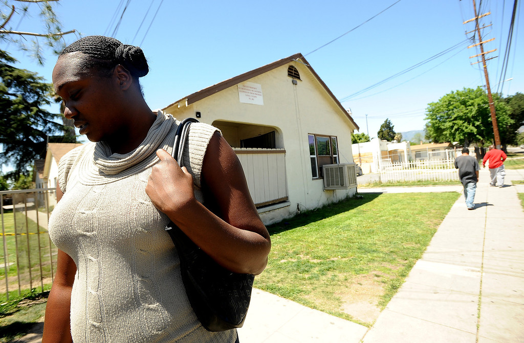 . Elizabeth Collins, 30, stands along North Sierra Way in San Bernardino April 18, 2013.  GABRIEL LUIS ACOSTA/STAFF PHOTOGRAPHER.