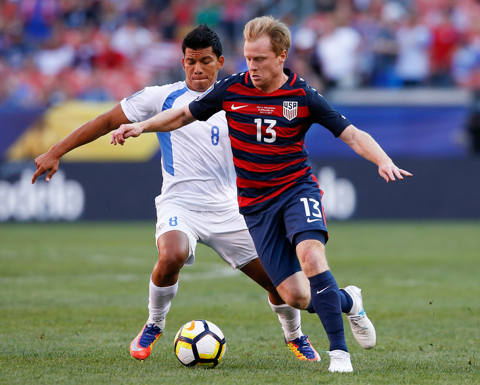 . United States\' Dax McCarty (13) works against Nicaragua\'s Marlon Lopez (8) during a CONCACAF Gold Cup soccer match in Cleveland, Saturday, July 15, 2017. (AP Photo/Ron Schwane)