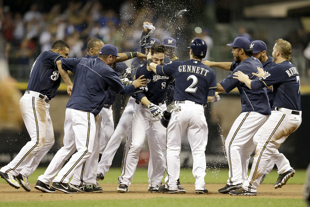 . MILWAUKEE, WI - JUNE 27: Ryan Braun of the Milwaukee Brewers celebrates after hitting a walk off single in the bottom of the ninth inning to put the brewers up 3-2 over the Colorado Rockies at Miller Park on June 27, 2014 in Milwaukee, Wisconsin. (Photo by Mike McGinnis/Getty Images)