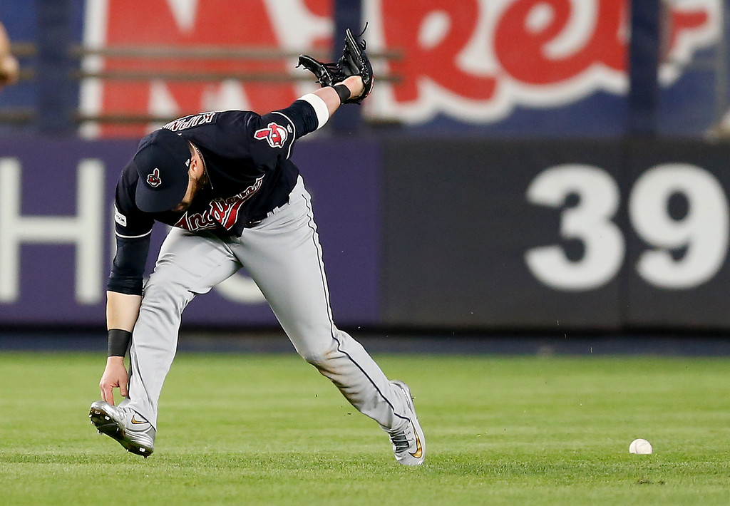 . Cleveland Indians center fielder Jason Kipnis can\'t make the catch on a hit by New York Yankees\' Brett Gardner during the eighth inning in Game 3 of baseball\'s American League Division Series, Sunday, Oct. 8, 2017, in New York. (AP Photo/Kathy Willens)