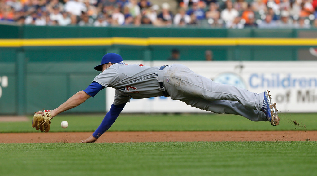 . Chicago Cubs third baseman Kris Bryant dives but is unable to stop a double to left by Detroit Tigers\' Rajai Davis during the first inning of a baseball game, Tuesday, June 9, 2015, in Detroit. (AP Photo/Carlos Osorio)
