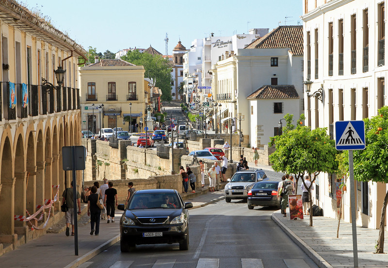 Main street of Ronda looking over Puente Nuevo (bridge) which connects the two halfs of the town.
