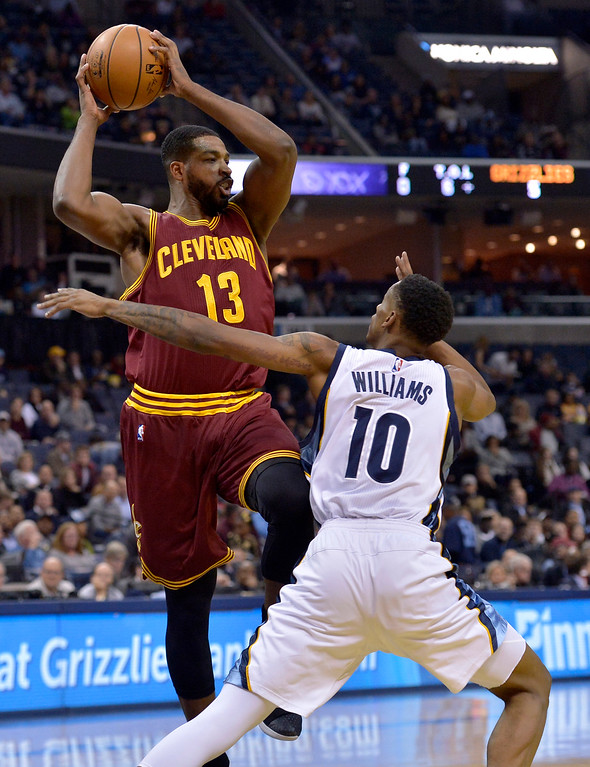. Cleveland Cavaliers center Tristan Thompson (13) controls the ball against Memphis Grizzlies forward Troy Williams (10) in the first half of an NBA basketball game Wednesday, Dec. 14, 2016, in Memphis, Tenn. (AP Photo/Brandon Dill)