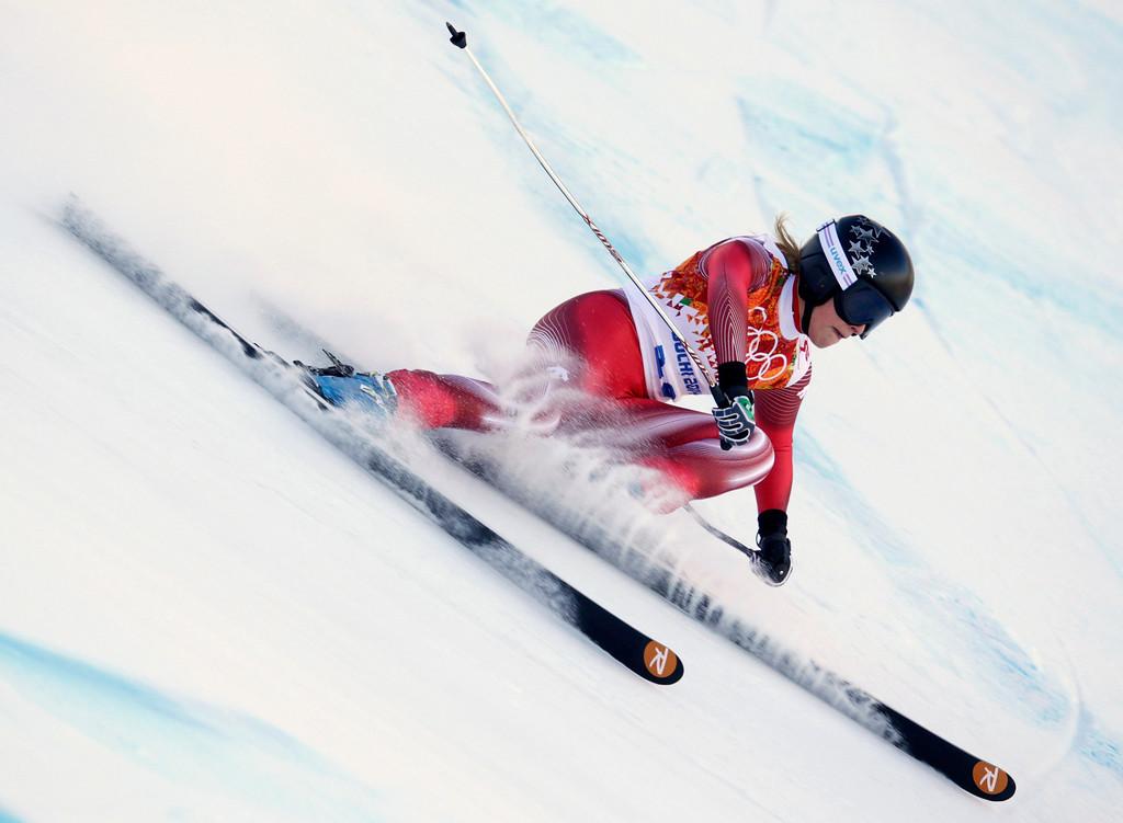 . Switzerland\'s Lara Gut makes a turn in the women\'s downhill at the Sochi 2014 Winter Olympics, Wednesday, Feb. 12, 2014, in Krasnaya Polyana, Russia. (AP Photo/Charles Krupa)