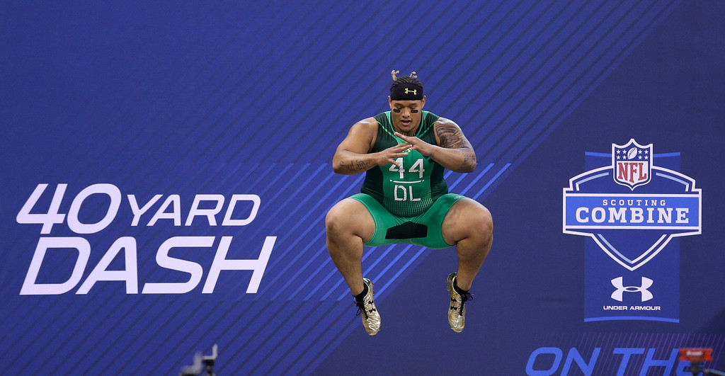 . Washington defensive lineman Danny Shelton jumps before running the 40-yard dash at the NFL football scouting combine in Indianapolis, Sunday, Feb. 22, 2015. (AP Photo/David J. Phillip)