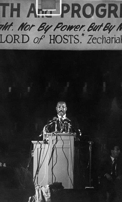 . Martin Luther King addresses 2,000 supporters of a sanitary workers\' strike at Memphis, Wednesday, Apr. 4, 1968 night, his last public appearance. King said in the speech now is the time he would rather live than any era in history. (AP Photo/Charles Knoblock)
