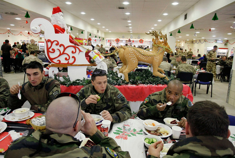 . French soldiers and service members with the NATO- led International Security Assistance Force (ISAF) eat Christmas dinner at a dining facility at the U.S.-led coalition base in Kabul, Afghanistan, Tuesday, Dec. 25, 2012. (AP Photo/Musadeq Sadeq)