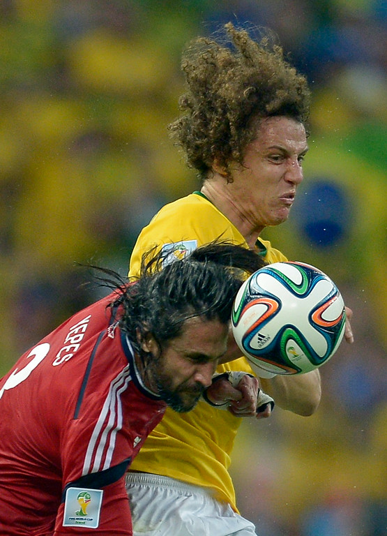 . Brazil\'s David Luiz, right, is challenged by Colombia\'s Mario Yepes during the World Cup quarterfinal soccer match between Brazil and Colombia at the Arena Castelao in Fortaleza, Brazil, Friday, July 4, 2014. (AP Photo/Manu Fernandez)