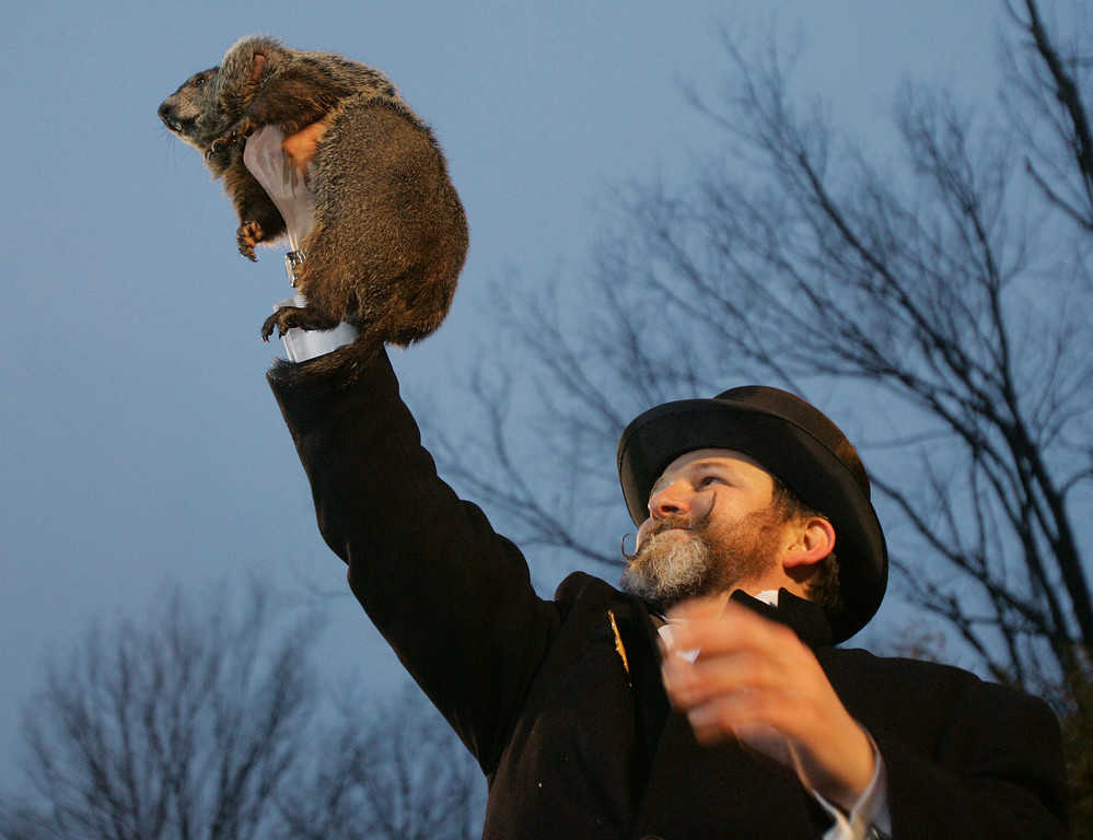 . Ben Hughes, one of the handlers of the weather predicting groundhog Punxsutawney Phil, holds Phil in the air after removing him form his stage stump on Ground Hog\'s Day in Punxsutawney, Pa. on Saturday, Feb. 2, 2008. The Groundhog Club said Phil saw his shadow and predicted six more weeks of winter. (AP Photo/Keith Srakocic)